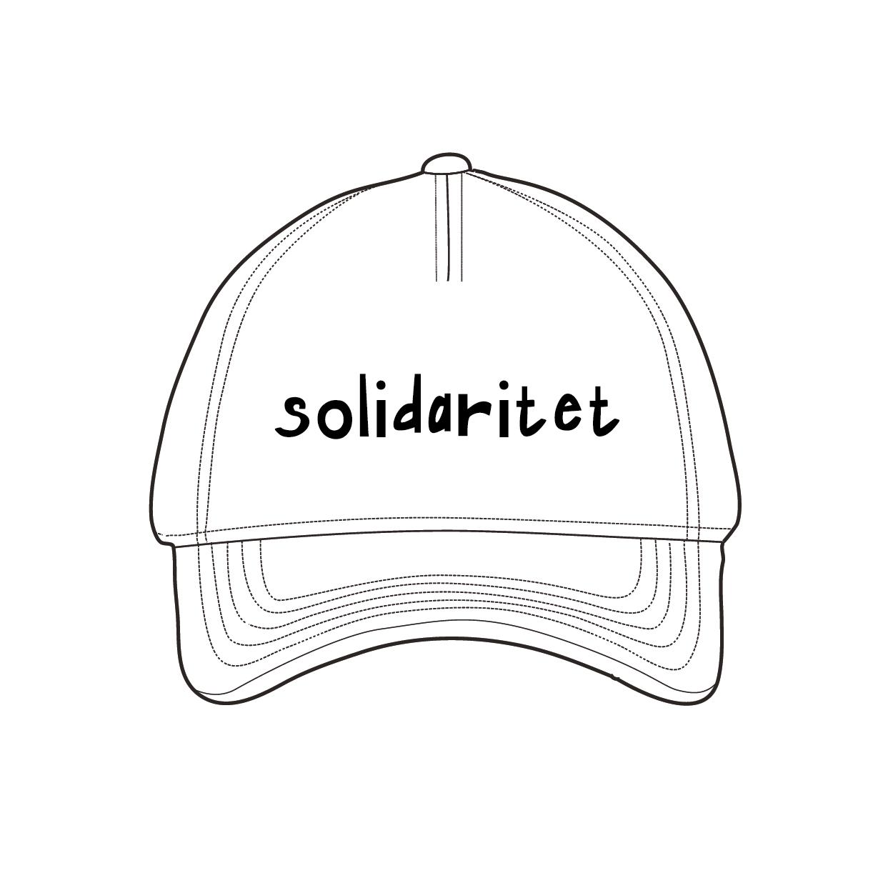 """Vit keps med texten: """"solidaritet"""""""